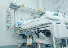 Bed in the intensive care with patient Stock Image