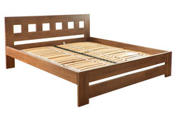 Bed on white Stock Images