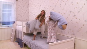 Bed Jumping Party. Two young girls having a jumping bed party stock video footage