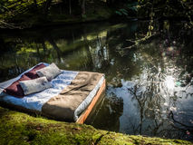 Bed on a lake Royalty Free Stock Photo