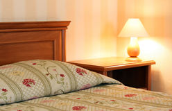 Bed with lamp Stock Photos
