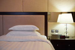 Bed and lamp in hotel room Royalty Free Stock Images