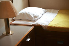 Bed and lamp in hut Royalty Free Stock Photo