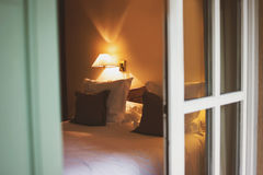 Bed and lamp on wall. Royalty Free Stock Image