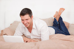 Bed laptop man Stock Photo