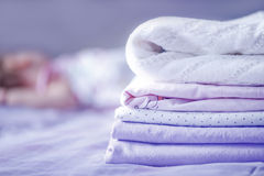 Bed-linen. Clear bed-linen for baby on the bad Stock Photography
