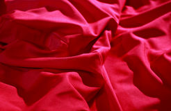 Bed linen shop. Wrinkles on the red silk vail detailed stock image Royalty Free Stock Photo