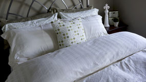 Bed Linens and Pillows Royalty Free Stock Photos