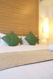 Bed in luxury hotel room Stock Image