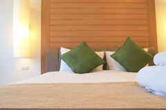 Bed in luxury hotel room Stock Photography