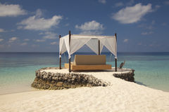 Bed in the Maldives. Beautiful sky and clear water stock images