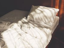 Bed Mattress Pillow unmade Bedroom Morning with sunlight stock photography
