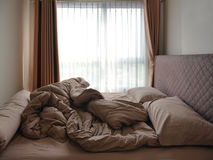 Bed Mattress Pillows and Blanket messed up in bedroom stock image