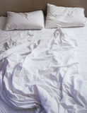 Bed Mattress Pillows and Blanket messed up Top view Royalty Free Stock Photos