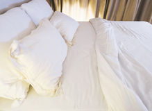 Bed mattress and pillows messed up in bedroom Stock Photos
