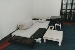 Bed-mattress in the room hermit ascetic. Poor living conditions. poverty. In India stock image