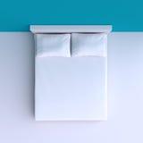 Bed met hoofdkussens en een deken in de hoekruimte, 3d illustratie Stock Foto