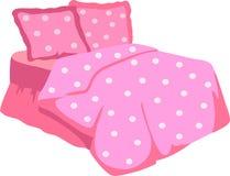 Bed met Roze Deken en hoofdkussen Stock Afbeelding