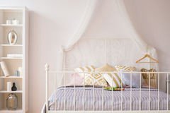 Bed with metal headboard Royalty Free Stock Photography