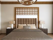 Bed in the Middle Eastern style with wooden carved headboard and bed Arabic textiles. 3D rendering royalty free illustration