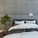 Bed In  Modern Concrete Room Royalty Free Stock Images