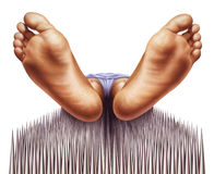 Bed of nails with fakir viewed from feet. Stock Photos