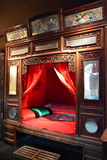 A bed for a newly married couple. This is 100 years ago China noble people get married with a bed, looks like the furniture in the wardrobe, wood is expensive Stock Photography