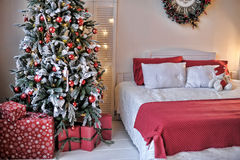 Bed next to the Christmas tree. Interior with a bed next to the Christmas tree Royalty Free Stock Photography