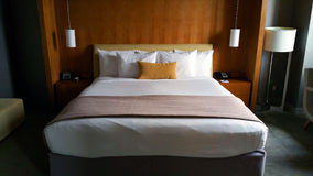 Bed. Nicely made bed in a hotel Stock Photography