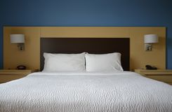 Bed with Nighstands and Lamps Stock Photography