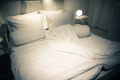 Bed at night Royalty Free Stock Images