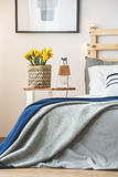 Bed and nightstand Stock Photos