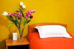 Bed with an orange coverlet stock photo