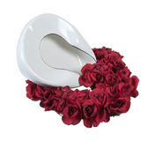 Bed Pan in a Bed of Roses Royalty Free Stock Photos