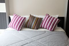 Bed and pillow Stock Photography