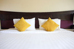 Bed and pillow in the hotel Royalty Free Stock Image