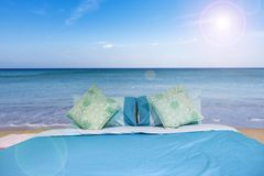 Bed with pillow in the nature happy summer holiday at the tropical sea royalty free stock image
