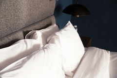 Bed with a pillow,table, lamp Stock Image