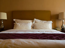 Bed and pillows Stock Image