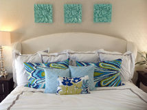 Bed With Pillows. Beautiful white bedroom with beautiful blue and white pillows Royalty Free Stock Image