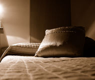 Bed and Pillows - B&W. Bed and coloured pillows - black and white Royalty Free Stock Photos