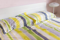 bed with pillows in bed room Stock Image