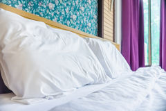 Bed, pillows and bedsheets in the bed room of hotel resort Royalty Free Stock Photo