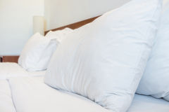 Bed, pillows, bedsheets and lamp in the hotel resort room Royalty Free Stock Photos