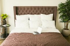 Bed with pillows with bedside table in bedroom stock image