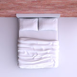 Bed with pillows and a blanket in the corner room, 3d illustration. Top view Royalty Free Stock Image