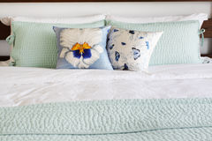 Bed and pillows with matching covers. King-size bed and pillows on matching covers Stock Photography