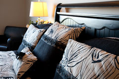 Bed and pillows in a modern hotel room Royalty Free Stock Photos