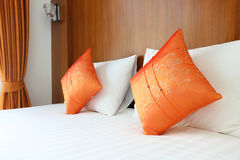 Bed, pillows in resort room Royalty Free Stock Image