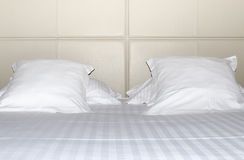 Bed with pillows Stock Photography